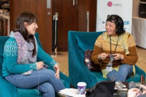 knitters sitting and knitting together at woollinn yarn festival